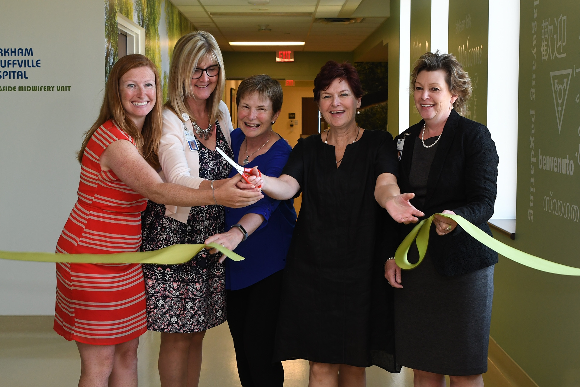 Hospital officials cutting ceremonial ribbon