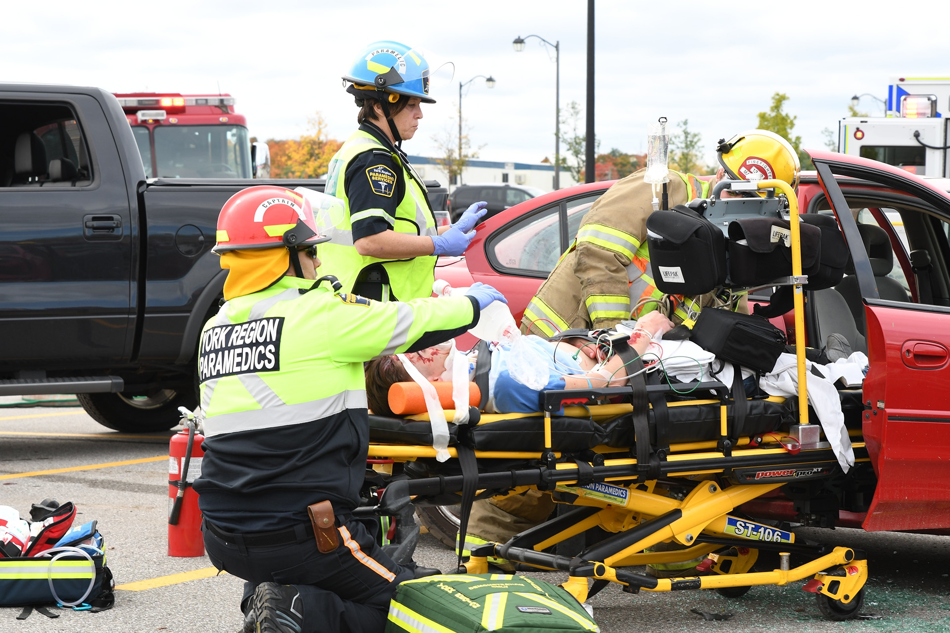 Paramedics working on an accident victim